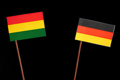 Bolivian flag with German flag isolated on black Stock Photo