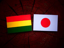 Bolivian flag with Japanese flag on a tree stump isolated Stock Images