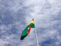 Bolivian flag in the sky. Blue sky with clouds and the bolivian flag dancing with the wind Stock Photos