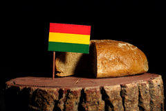 Bolivian flag on a stump with bread Stock Images