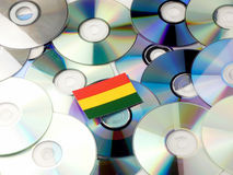 Bolivian flag on top of CD and DVD pile isolated on white Royalty Free Stock Photo