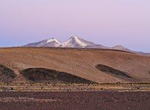 Bolivian Landscape. Bolivia, Potosi Departmant, Sur Lipez Province, Eduardo Avaroa Andean Fauna National Reserve, Sol de Manana, Nightfall view towards Volcano Stock Photography