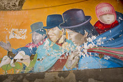 Bolivian Lifestyle. Colorful graffiti in La Paz, Bolivia. LA PAZ, BOLIVIA, JANUARY 3: Graffiti of Bolivian lifestyle painted  on old wall by unknown artist Royalty Free Stock Photos