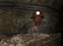 A bolivian miner. Miners in the mine of Potosi, Bolivia, South America. Once famous for its silver, is now used to extract more common minerals. The harsh stock images