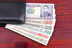 Bolivian money in the black wallet Stock Image