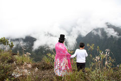 Bolivian mother and child enjoy the view of mountains Royalty Free Stock Images