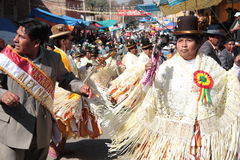 Bolivian People dance in a street at the holiday Stock Photos