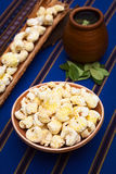 Bolivian Snack Pasancalla (Sweetened Popped White Corn). Sweetened popped white corn called Pasancalla eaten as snack in Bolivia served in a clay bowl with coca Royalty Free Stock Image