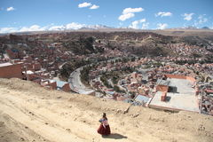 Bolivian woman and mountain view of La Paz, Bolivia Stock Photos