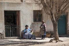 Bolivian women along the road to Oruro - Bolivia stock photo