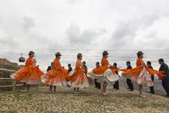 Bolivian women dancing in folklore clothes during carnival in La Royalty Free Stock Photography