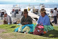 Bolivian women at Titicaca lake Stock Photo