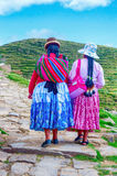 Bolivian  women in traditional clothes on the street Stock Images