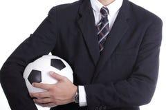 Boll för fotbollchefhåll Royaltyfria Bilder
