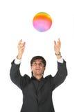 bollaffärsmannen fångar multicolor Arkivbild