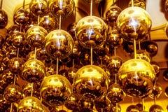 Bollar med reflexion, bollar av guld- färg Fotografering för Bildbyråer