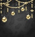 Bollar och prydnad för jul guld- på svart bakgrund Arkivfoton