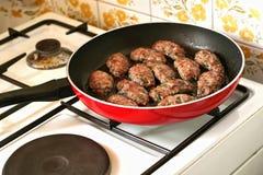 bollar som lagar mat meat Arkivbild