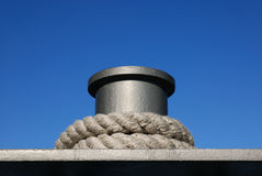Bollard. With thaw on blue sky stock photography