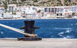Bollard. With blurred city of Cesme in the background royalty free stock photos