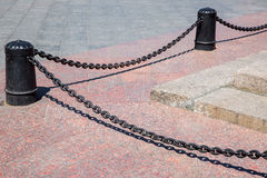 The bollard cast-iron black. Royalty Free Stock Photo