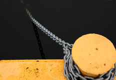 A bollard and chain. For attaching boats on the water Royalty Free Stock Image