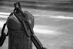 Bollard and chain in black and white 1 Stock Photo