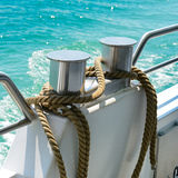 Bollard with coiled rope. On board ship Stock Photography