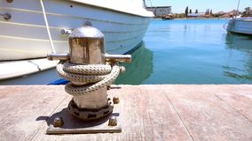 Bollard in Dock and Boats. And seasonal holiday and fishing stock video footage
