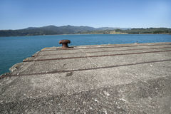 Bollard on end of disused wharf. At Hicks bay, New Zealand Royalty Free Stock Images