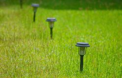 Bollard With Green Grass Royalty Free Stock Photos
