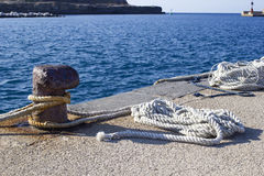 Bollard in harbor. Bollard and rope in new harbor of ventotene royalty free stock photography