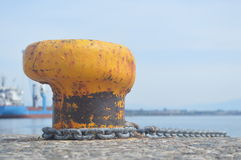 Bollard with metal mooring line Royalty Free Stock Photo