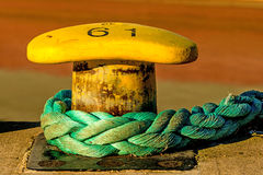 Bollard with mooring line Royalty Free Stock Photography