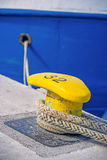 Bollard with mooring line of a trawler Stock Photos