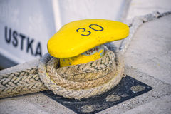 Bollard with mooring line of a trawler. Of Ustka, Poland Stock Photo