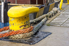 Bollard with mooring lines Stock Image