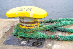 Bollard with mooring lines Royalty Free Stock Photos