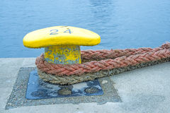 Bollard with mooring lines Royalty Free Stock Photo