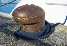 Bollard and mooring rope for mooring of yachts and boats Royalty Free Stock Photography