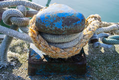 Bollard and mooring rope for mooring of yachts and boats.  Stock Photos