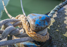 Bollard and mooring rope for mooring of yachts and boats.  Royalty Free Stock Images