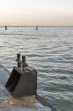 Bollard for mooring water buses in Venice lagoon, Italy. Stock Photos