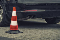 Bollard next to car. no parking on pavement Royalty Free Stock Images
