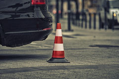 Bollard next to car. no parking on pavement concept Royalty Free Stock Images
