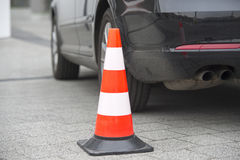 Bollard next to car. no parking on pavement concept Royalty Free Stock Photo