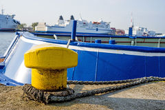 Bollard at a pier with ferry Stock Images