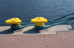 Bollard, port detail and ship Stock Photography