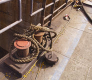 Bollard with rope Stock Images