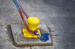 Bollard with Rope Ties Royalty Free Stock Photo
